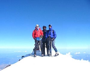 Jim Ewing, at right, stands at the summit of Russia's Mount Elbrus in 2004 with Atlanta trial lawyers Ken Canfield, left, and Dave Schaeffer.