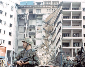 American Marines stand guard in front of the ruins of the American embassy, Beirut, 1983.