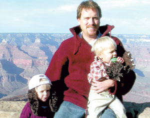 Mark Hummels with his children at the Grand Canyon.